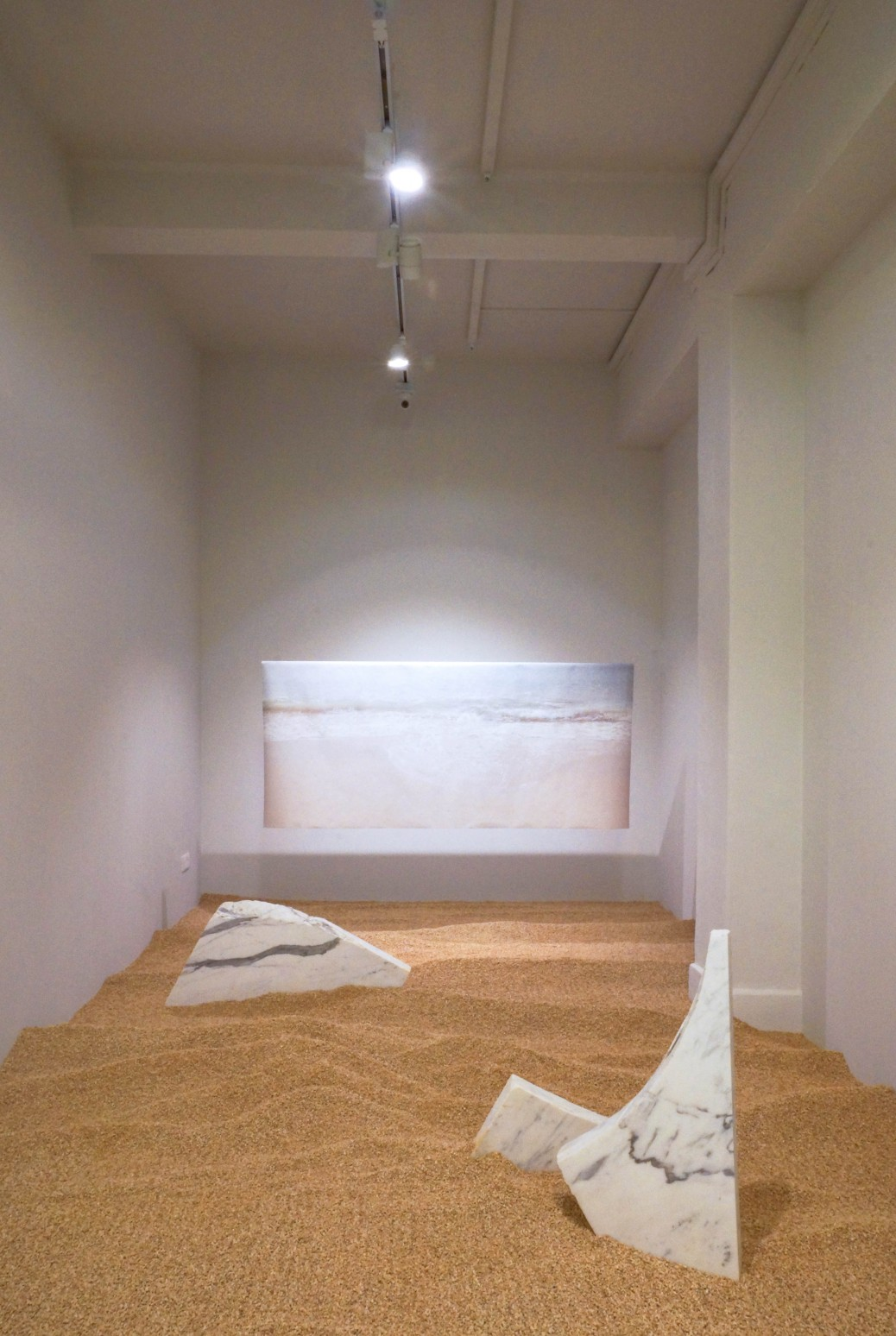 Zen Teh, Movement : Stillness, 2018, installation of pebbles, marble pieces, and inkjet print on Japanese handmade paper, dimensions variable