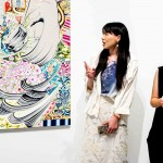 From left to right: Mizuno Rina (artist) with Lim Sim Lin (translator) explaining about her work, Mansion in a Mountain Range, 2019, oil on canvas, 162 × 130 cm, © Mizuno Rina, courtesy of Mizuma Gallery
