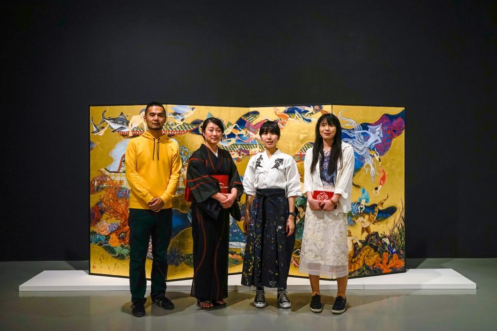 From left to right: Kobayashi Satoshi (artist), Kimura Ryoko (artist), Kato Ai (Ai☆Madonna) (artist), and Mizuno Rina (artist), standing in front of Kimura Ryoko's The Sea of the Enchanted City - Paradise of Dragon Palace, 2016, © Kimura Ryoko, courtesy of Mizuma Gallery